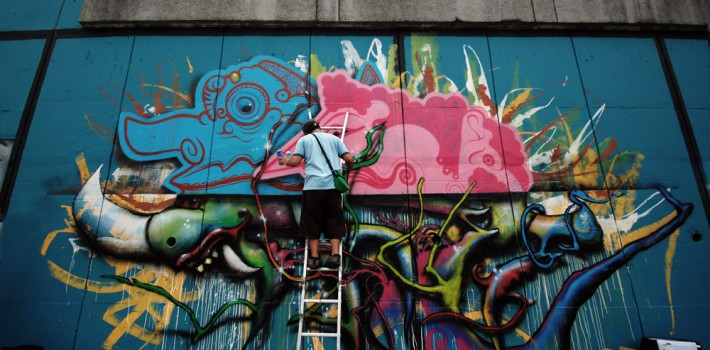 Famous-local-graffiti-artist-They-working-on-his-piece-at-sg.-klang-web